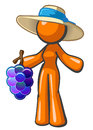 Orange lady holding large bunch of grapes Royalty Free Stock Image