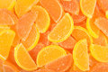 Orange and lemon candy slices as background Royalty Free Stock Photo