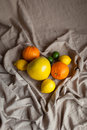 Orange lemon lime on the drapery of a heart draped cloth Royalty Free Stock Images