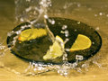 Orange and lemon on a wooden with waterdrops Royalty Free Stock Photo