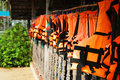 Orange life jackets row of many Royalty Free Stock Photography