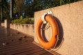 Orange lifebuoy haning wall Royalty Free Stock Images