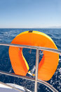 Orange lifebuoy on sailing ship Stock Photography