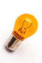 Orange light bulb Stock Images