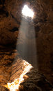 The orange light through hole in the cave Stock Image