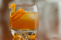 Orange liquor on the rocks served with an twist as a garnish Stock Photography