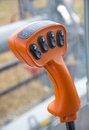 Orange machinery joystick with buttons black Royalty Free Stock Photos