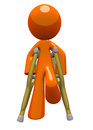 Orange Man with Crutches Front View Royalty Free Stock Photo