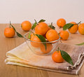 Orange mandarins in a glass bowl Stock Image
