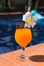 Orange mango fresh juice smoothie drink cocktail slippers near s Royalty Free Stock Photo