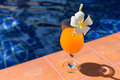 Orange mango fresh juice smoothie drink cocktail slippers near s Royalty Free Stock Photo