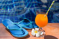 Orange mango fresh juice smoothie drink cocktail slippers and su Royalty Free Stock Photo