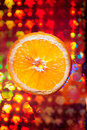 Orange  with many water drops on the abstract background Royalty Free Stock Photo
