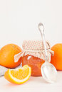 Orange marmalade jar of homemade with fresh fruits over a white background vintage style photography Stock Image