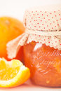 Orange marmalade jar of homemade with fresh fruits over a white background vintage style photography Stock Photography