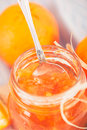 Orange marmalade jar of homemade with fresh fruits over a white background vintage style photography Royalty Free Stock Image