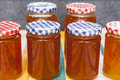 Orange marmalade jars full of homemade Royalty Free Stock Photography