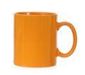 Orange mug for coffee or tea isolated on white background Stock Images