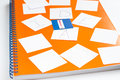Orange notebook on a spring. Cards with letters I, D
