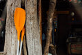 Orange oars on a wooden background. Two orange paddles for a sea boat or kayak Royalty Free Stock Photo