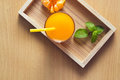 Orange and orange juice with mint in tray wood on wooden background Royalty Free Stock Photo