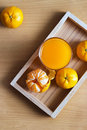 Orange and orange juice in tray wood on wooden background Royalty Free Stock Photo