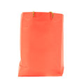 Orange paper shopping bag isolated on white Royalty Free Stock Images