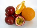 Orange passion fruit and oranges a colorful arrangement Stock Photo