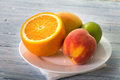 Orange peach and lime on plate Stock Photography
