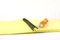 Orange pen on the yellow writing book shallow dof Stock Images