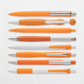 Orange pens collection with ps path isolated on white background Royalty Free Stock Photos
