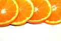 Orange pieces on white background colored Stock Photography