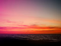 Orange and pink sunset sky over beach Royalty Free Stock Photo