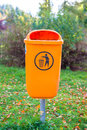 Orange plastic dust bin in an old medieval european town Stock Photo