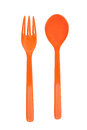 Orange plastic fork and spoon Royalty Free Stock Photo