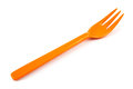 Orange plastic forks isolated Royalty Free Stock Photo