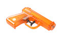 Orange plastic water pistol isolated on a white background Stock Image