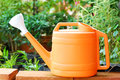 Orange plastic watering garden Stock Photography