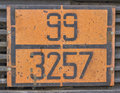 Orange plate with hazard identification number on bitumen tank Royalty Free Stock Photo