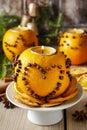 Orange pomander ball with candle, christmas decoration Royalty Free Stock Photo