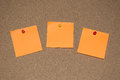 Orange Post it Notes on a Cork Board Royalty Free Stock Photo