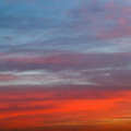 Orange red and blue early morning sunrise sky Royalty Free Stock Photo