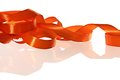 Orange ribbon on the white background Stock Photo