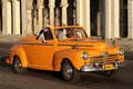 Orange roadster on the boulevard havana cuba february classic old american car in streets of havana classic cars are still in use Royalty Free Stock Photography