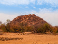 Orange rock formation of damaraland near twyfelfontein namibia Royalty Free Stock Photo