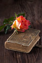 Orange rose with old book Royalty Free Stock Photo