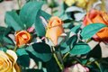 Orange roses and blue leaves Royalty Free Stock Photo