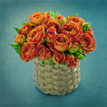 Orange roses on blue textured background bouquet of in a vase vintage shabby chic Royalty Free Stock Photos