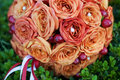 Orange roses round wedding bouquet bridal with brier berries Stock Photography