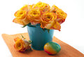 Orange roses in a tin bucket and easter eggs Royalty Free Stock Image